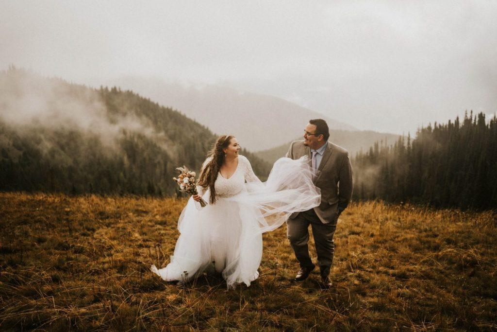 bride and groom walking toward camera at hurricane ridge elopement