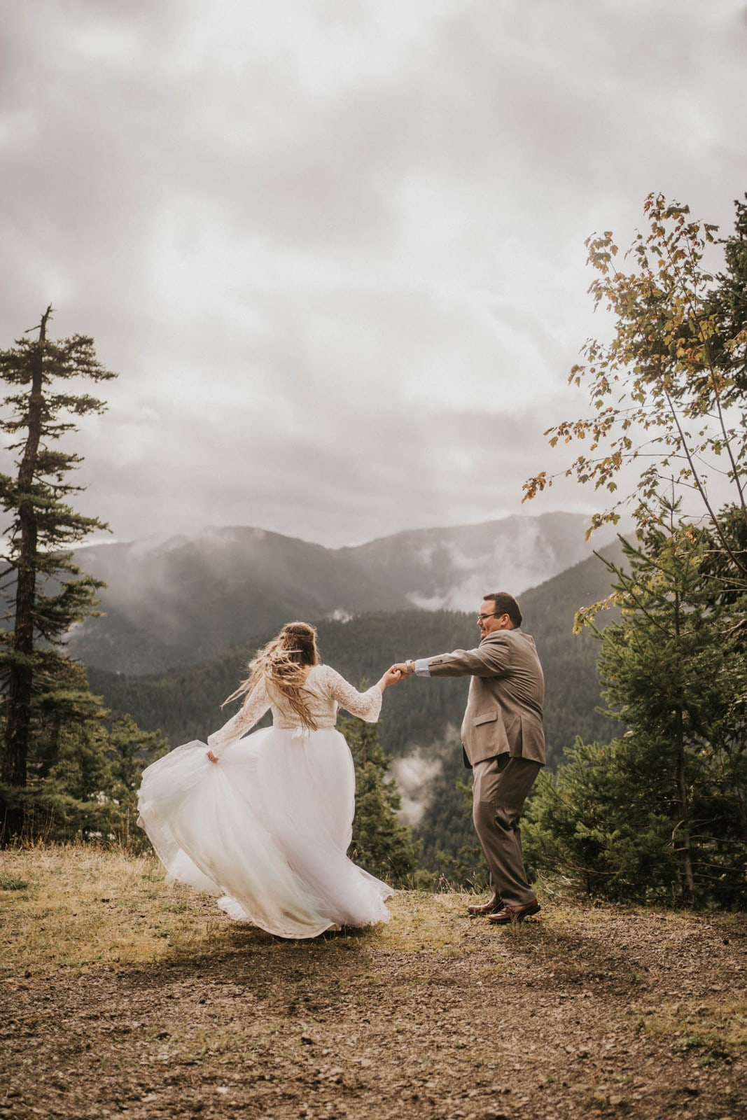 groom twirling bride at hurricane ridge elopement