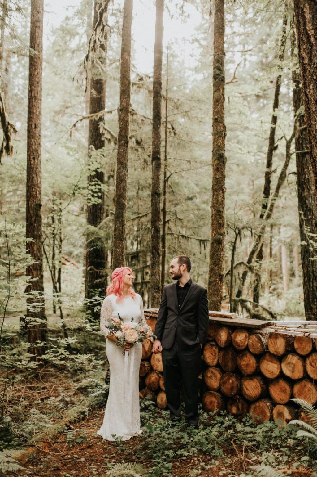 bride and groom looking at each other at alternative mountain elopement