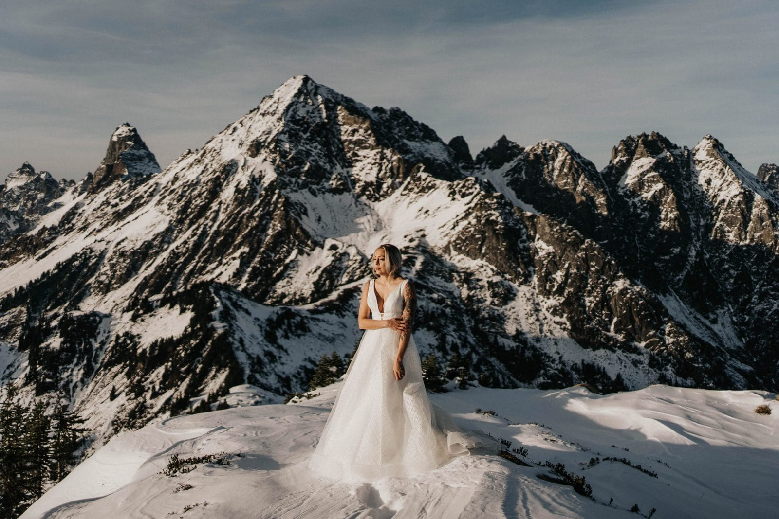 bride standing in front of the mountains at mount baker elopement