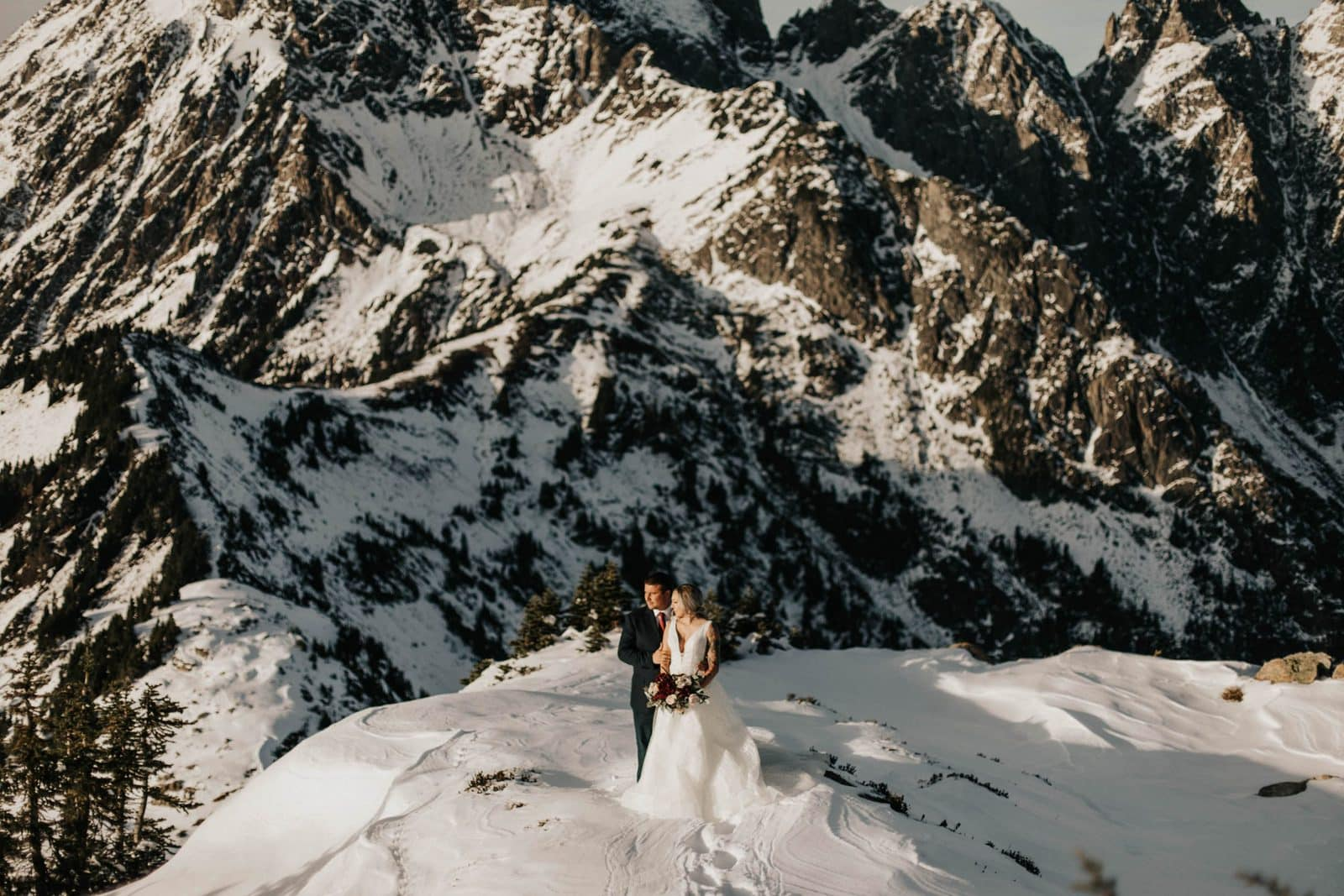 bride and groom standing in front of mountains at mount baker elopement