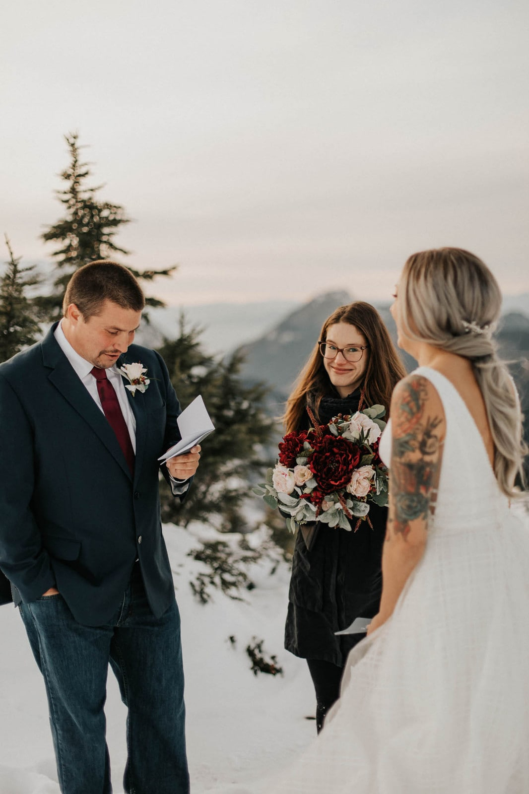 groom reading his vows at ceremony