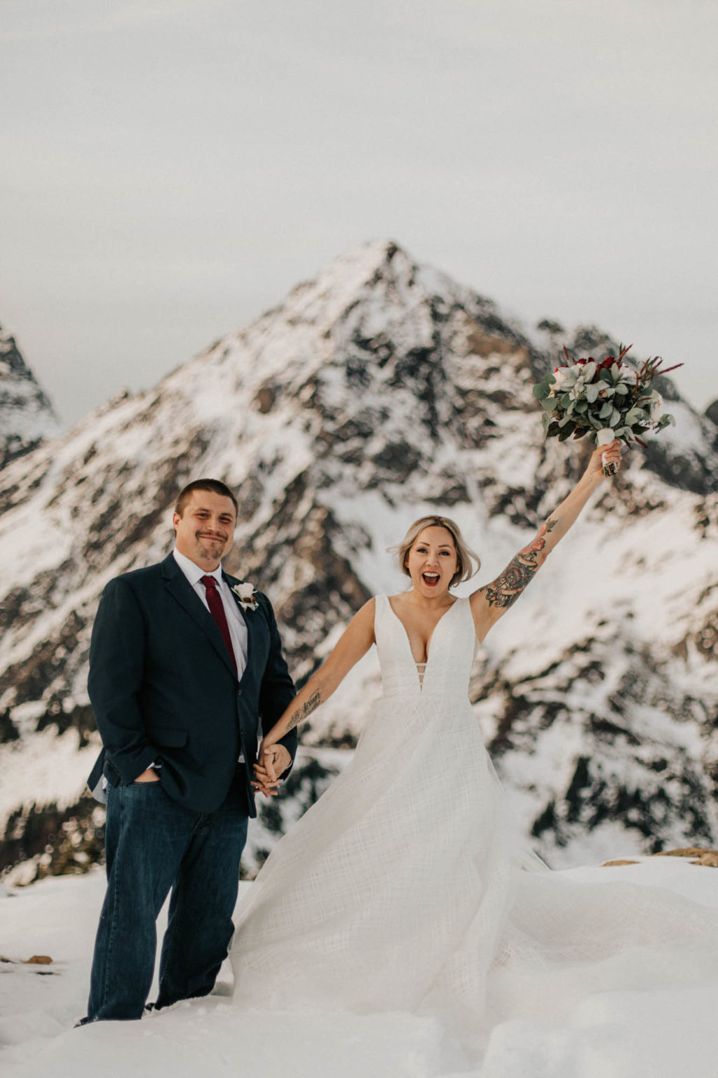 bride and groom cheering after ceremony at mount baker elopement