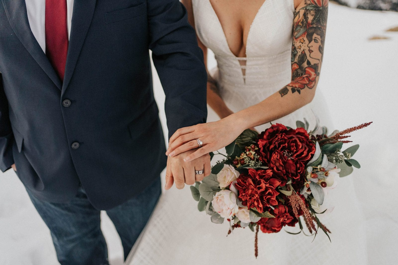 closeup of rings and bouquet