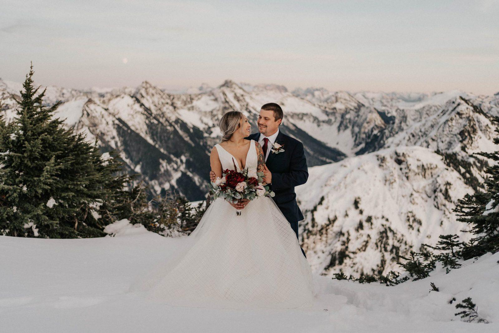 groom hugging bride from behind