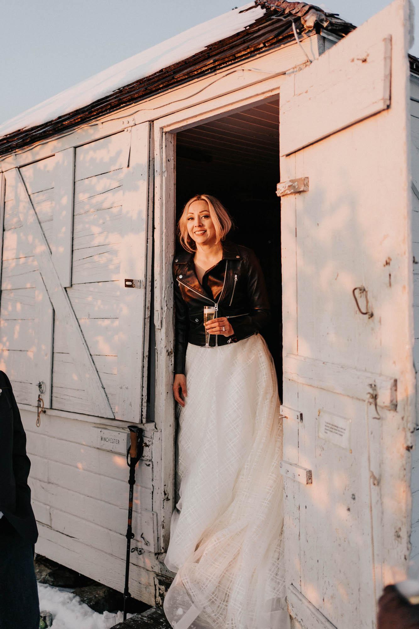 bride standing in doorway at lookout