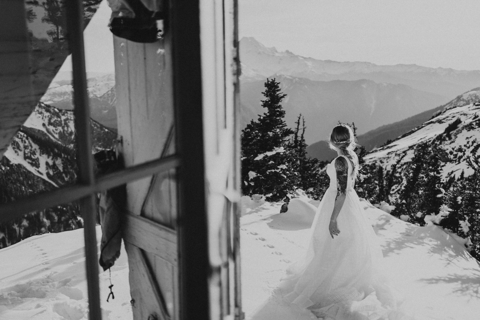 black and white of bride standing in the snow at Mount Baker elopement
