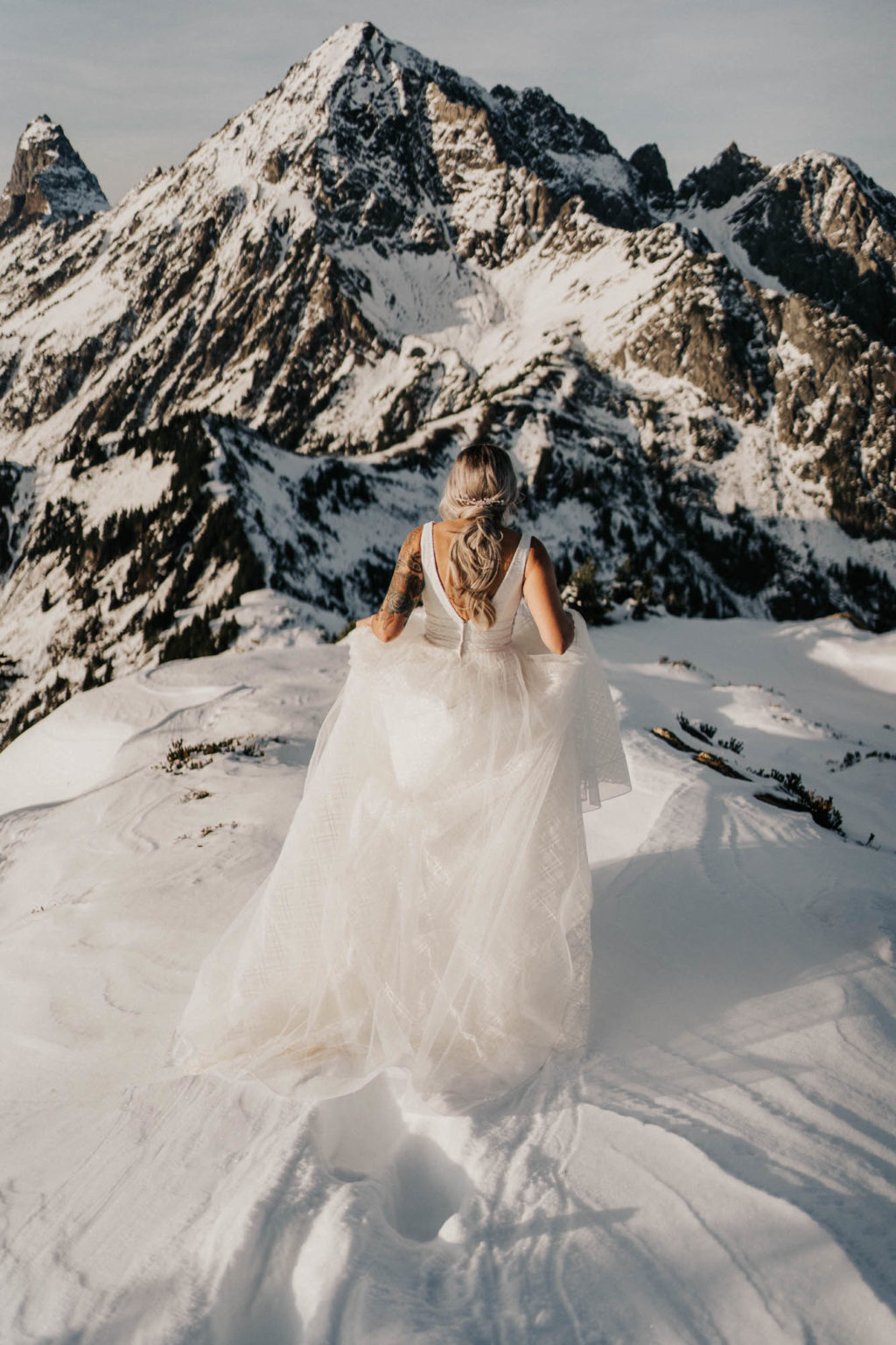 bride walking toward the mountains at mount baker elopement