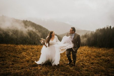bride and groom walking toward camera at hurricane ridge elopement